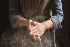 Woman clapping hands and sprinkling flour Stock Photography