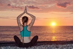 Woman with clasped hands over her head Beach, sunset.  Stock Photos