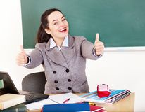 Woman in classroom. Young woman in classroom royalty free stock photography
