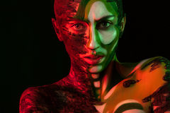Woman with clay on face and body painting Royalty Free Stock Photography