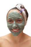 Woman with a clay mask Stock Photos