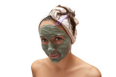 Woman with a clay mask Stock Image