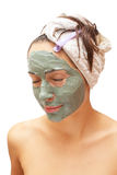 Woman with a clay mask Stock Photography