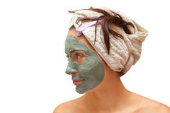 Woman with clay mask Stock Images