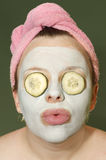 Woman with clay mask. Woman relaxing with clay mask Royalty Free Stock Images
