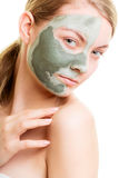 Woman in clay mud mask on face isolated on white. Stock Photos