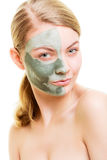 Woman in clay mud mask on face isolated on white. Royalty Free Stock Photo
