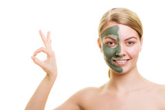 Woman in clay mud mask on face isolated on white. Royalty Free Stock Image