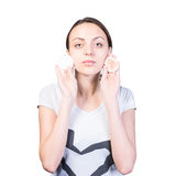Woman with Clean and Dirty Cottons Close to Face Stock Photos