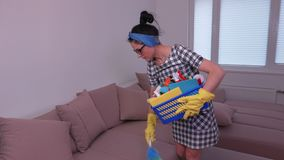 Woman clean dust from the sofa. In room stock footage