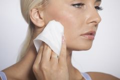 Woman clean face with wet wipes Stock Photography