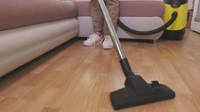 Woman clean floor with vacuum cleaner. In room stock footage