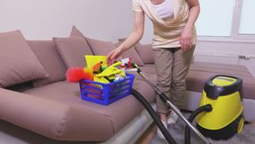 Woman clean rug with vacuum cleaner. In room stock video footage