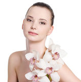 Woman with clean skin and flowers Royalty Free Stock Image