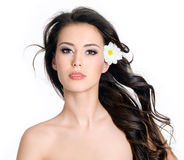 Woman with clean skin and flowers in her long hair Royalty Free Stock Photo