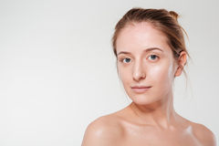Woman with clean skin looking at camera Stock Images