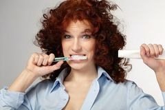 Woman clean teeth Royalty Free Stock Image