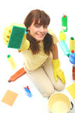 A woman cleaning. A smiling woman with sponge,bottles of household chemistry,wiper and bucket isolated on a white background stock images