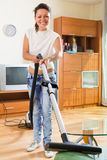 Woman cleaning apartments with vacuum cleaner Royalty Free Stock Photos