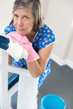 Woman cleaning banisters. And looking exhausted stock images