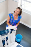 Woman cleaning banisters. And looking nosy royalty free stock images