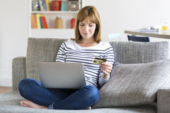 Woman cleaning the bank account of her husband with credit card Royalty Free Stock Photography