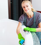 Woman cleaning bath Royalty Free Stock Image