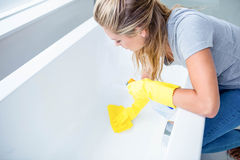 Woman cleaning the bath tub. In the bathroom stock images