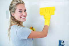 Woman cleaning the bathroom Royalty Free Stock Photo