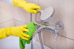 Woman cleaning bathtub Stock Images