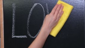 Woman cleaning on blackboard love concept stock video