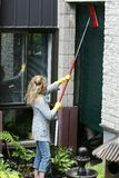 Woman cleaning a blind Royalty Free Stock Image