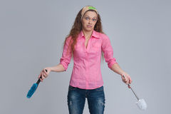 Woman with cleaning brush Royalty Free Stock Photography