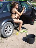 Woman cleaning car 4 Royalty Free Stock Photo