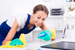 Woman cleaning in company office Royalty Free Stock Photo