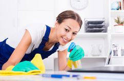 Woman cleaning in company office Stock Image