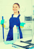 Woman cleaning at company office Royalty Free Stock Photography