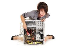 Woman cleaning computer Royalty Free Stock Photography