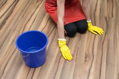 Woman cleaning concept. Woman washes the stain off the floor wearing yellow rubber gloves stock photos