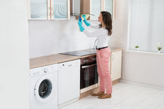 Woman Cleaning Cooker Hood Royalty Free Stock Photography