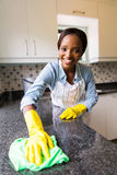 Woman cleaning counter Stock Images