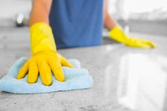 Woman cleaning the counter. In the kitchen stock image
