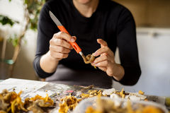 Woman cleaning craterellus mushroom Royalty Free Stock Photo