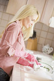Woman Cleaning Dishes Royalty Free Stock Image