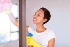 Woman cleaning door glass Stock Photo