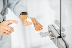 Free Woman Cleaning Door Handle At Home Royalty Free Stock Image - 176554146