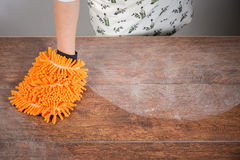 Woman cleaning dusty table Royalty Free Stock Photography