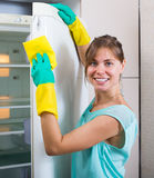 Woman cleaning empty refrigerator Stock Images