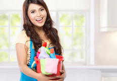 Woman with cleaning equipment. Portrait of beautiful asian woman with many cleaning equipment royalty free stock photo