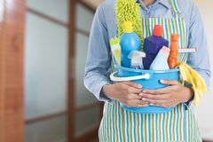 Woman with cleaning equipment ready to clean house in the room b. Ackground, close up stock photos